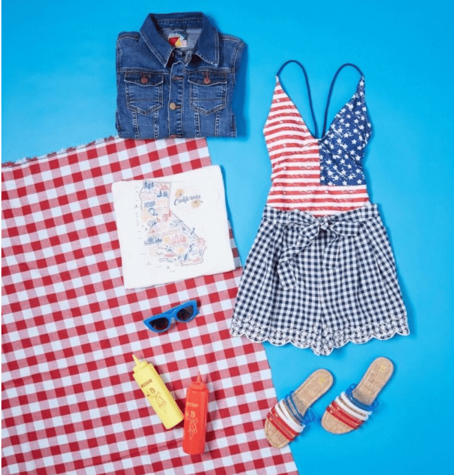 Pictured: Sand of the Free One-Piece Swimsuit, Coast's Pick Tank Top, I Am What I Gingham High-Waisted Shorts, Casually Dashing Denim Jacket, Color Me Casual Sandal in Americana, Worth Its Weight in Bold Sunglasses in Cobalt